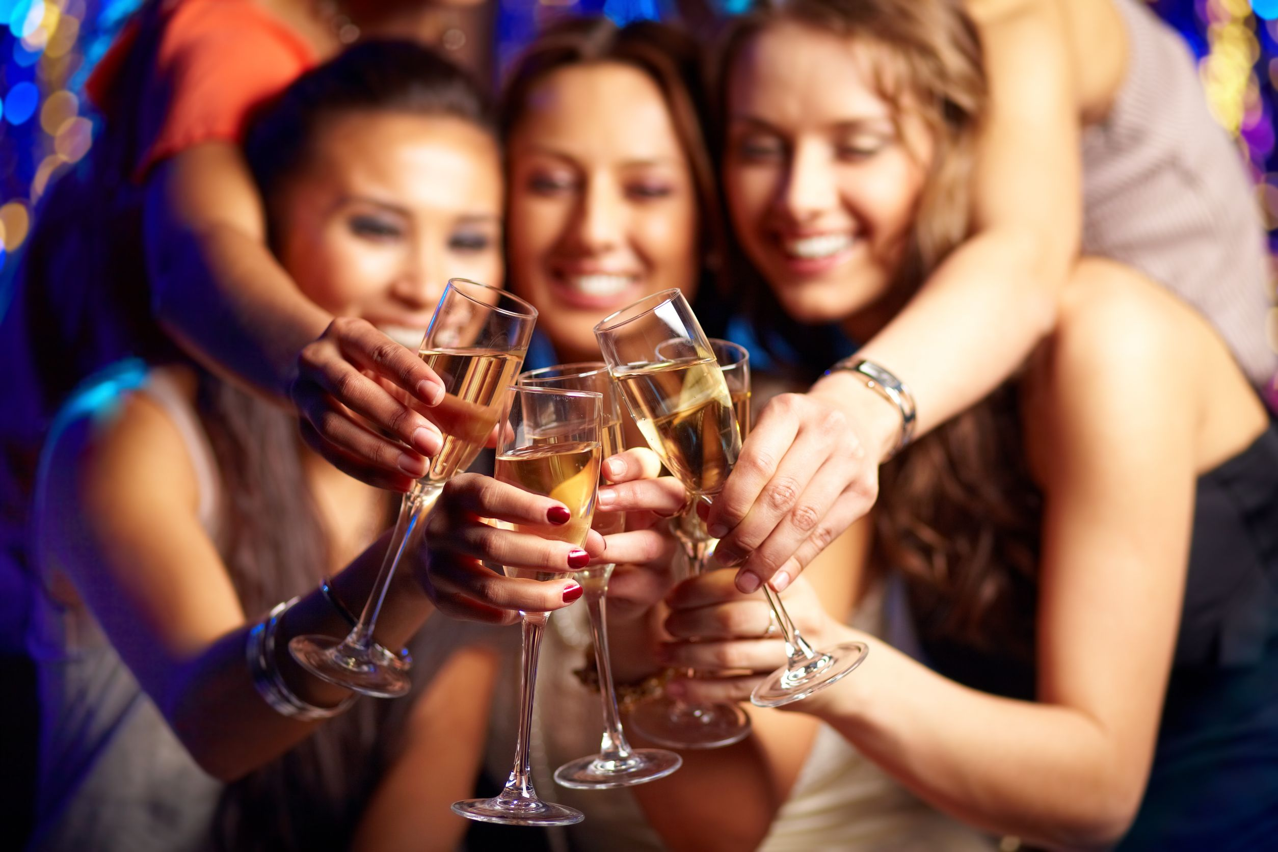 13301706 - group of partying girls clinking flutes with sparkling wine