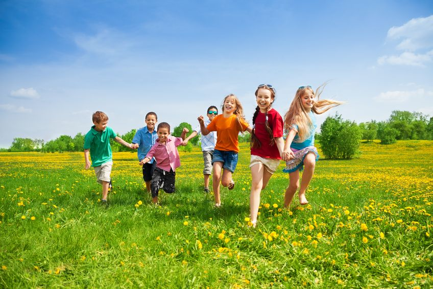 20981386 - large group of kids running in the dandelion spring field