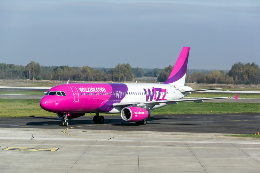 33326975 - katowice, poland - october 25: pink airbus a320-232 aircraft of wizzair company in katowice airport, poland on october 25, 2014: wizzair is a low-cost aerolines company operating through europe.