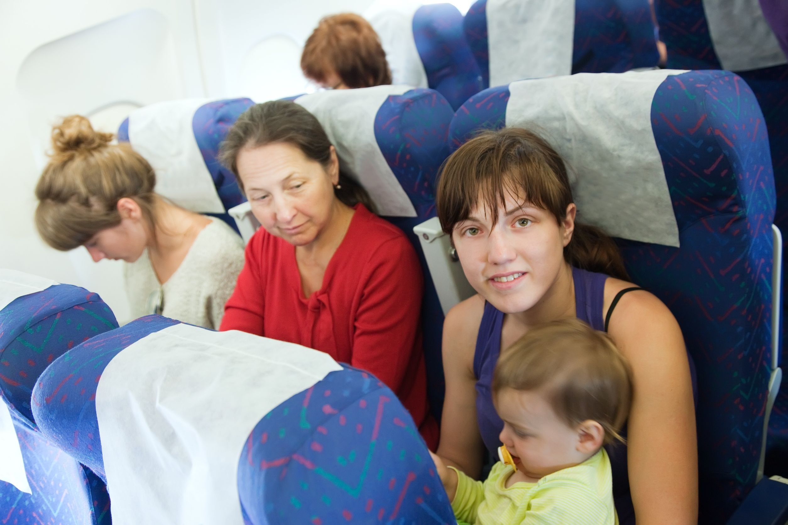 12289104 - women with child in the airplane cabin
