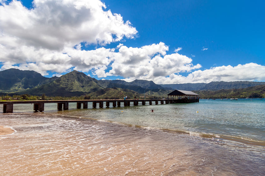 37758804 - kauai, hi, usa - august 31, 2013: tourists on pier and bathing in hanalei bay, kauai island (hawaii)