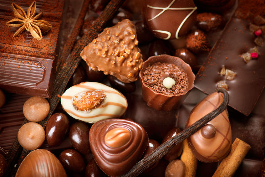 38253359 - chocolates background. praline chocolate sweets