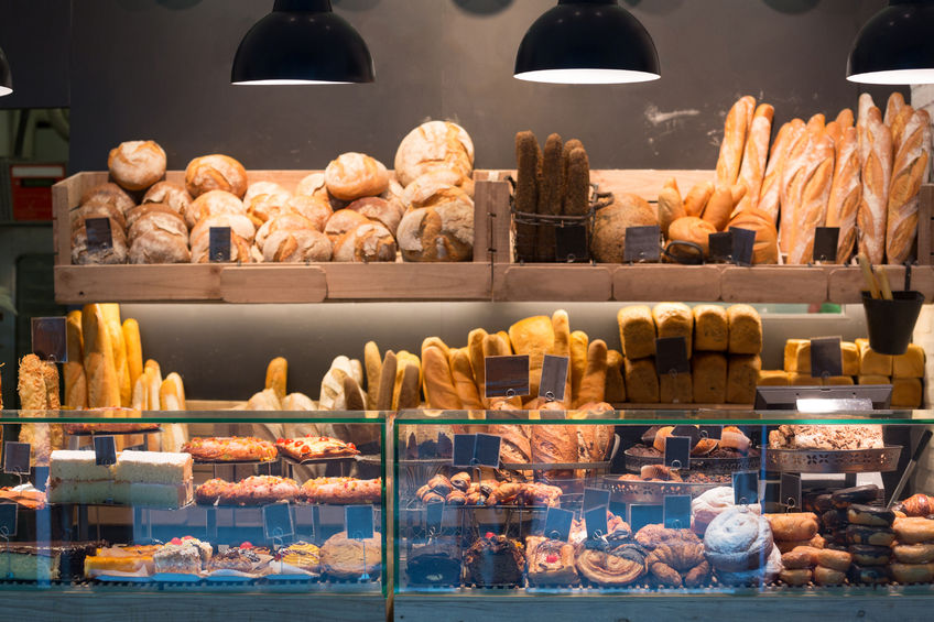 44755642 - modern bakery with assortment of bread, cakes and buns