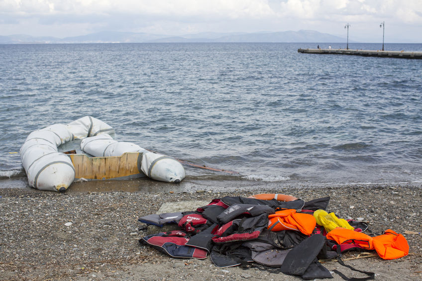 45924775 - kos, greece - sep 28, 2015: life jackets discarded on a beach. kos island is located just 4 kilometers from the turkish coast and refugees come from turkey in an inflatable boat.