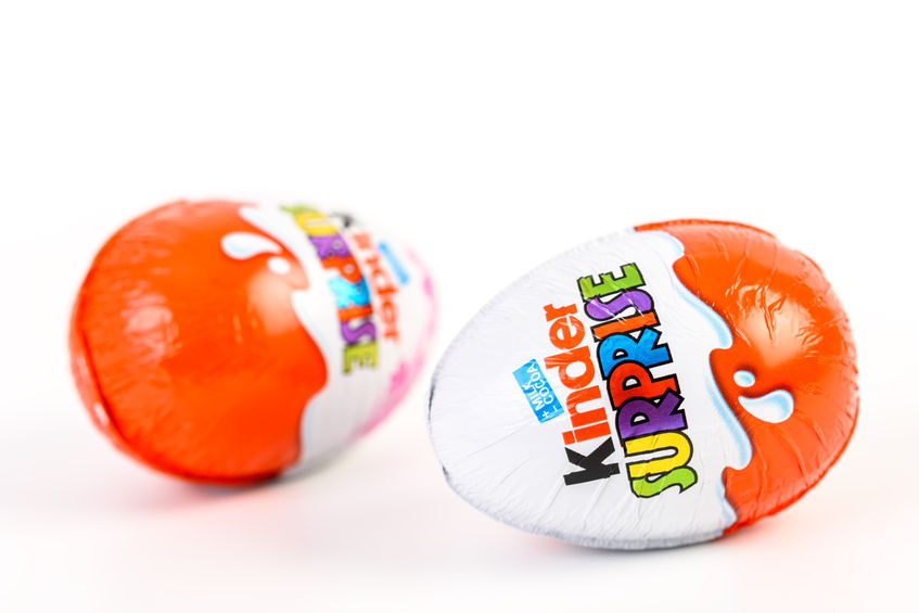 53643998 - bucharest, romania - december 02, 2015: kinder surprise chocolate eggs are a confection manufactured by ferrero company and has the form of a chocolate egg containing a small toy.