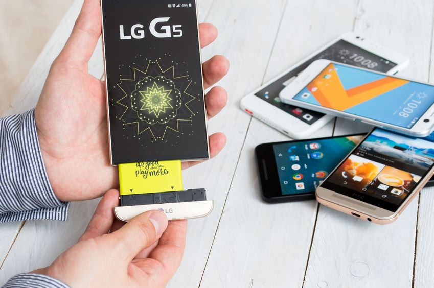 62016137 - wroclaw, poland- august 18th, 2016 : proffesional advisor shows new project of  lg g5 which is an android smartphone developed by lg electronics. g5 got replaced alternative add-on modules such as a camera grip or a high-fidelity audio.