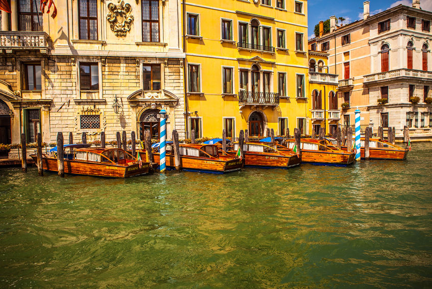 63476013 - venice, italy - august 19, 2016: retro brown taxi boat on water in venice on august 19, 2016 in venice, italy.
