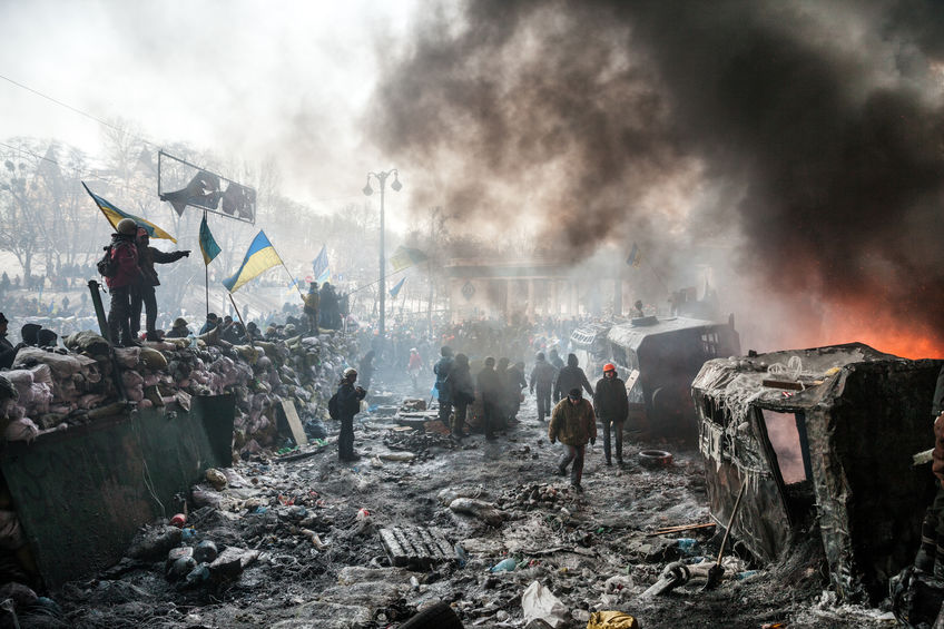 25386976 - kiev, ukraine - january 25, 2014: mass anti-government protests in the center of kiev. barricades in the conflict zone on hrushevskoho st.