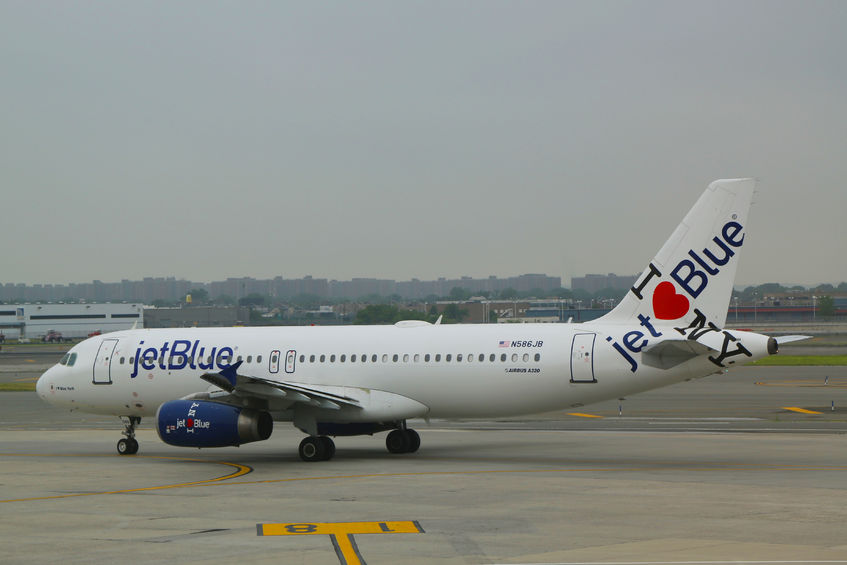 30093593 - new york- june 10 jetblue airbus a320 with ny s hometown airline tailfin design taxing at john f kennedy international airport in new york on june 10, 2014