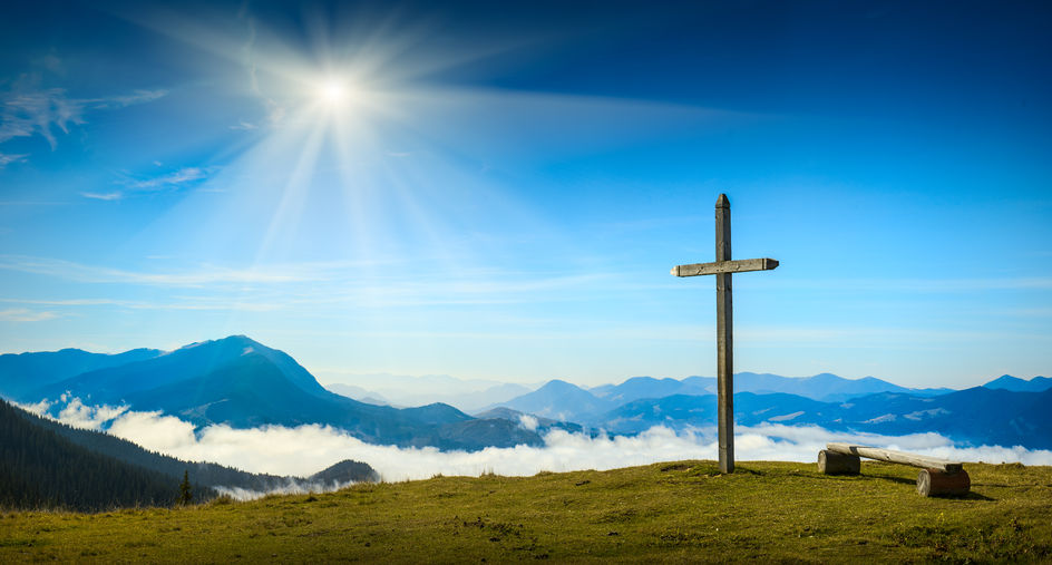 38328541 - place for rest with christian cross on a top of mountain above the sunny foggy valley. carpathian mountains, ukraine.