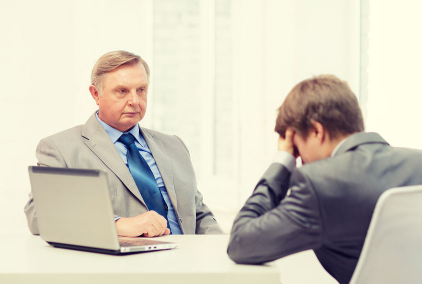 40249582 - business, technology and office concept - older man and young man having argument in office