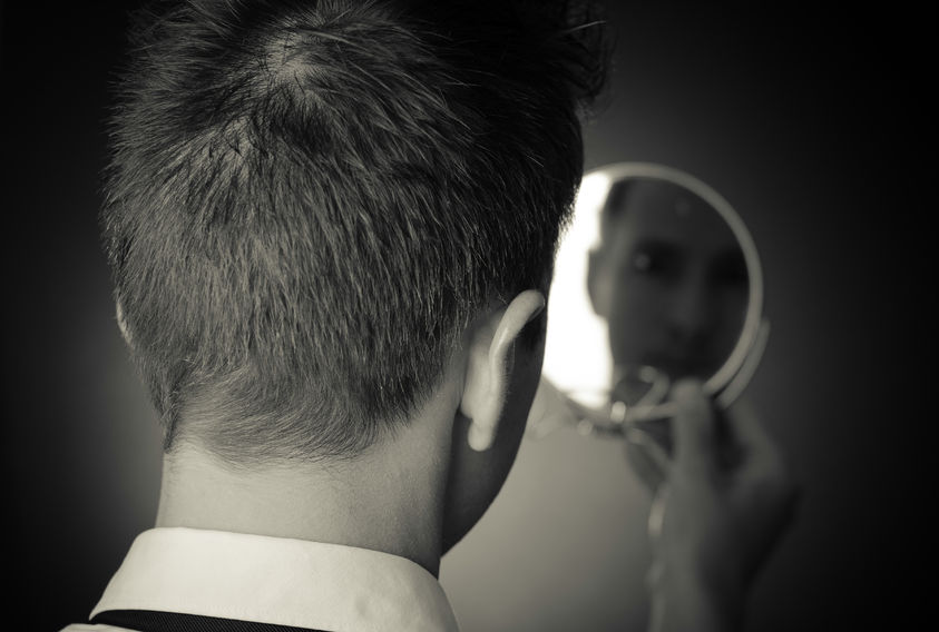 43277074 - ego business man looking in the mirror and reflecting