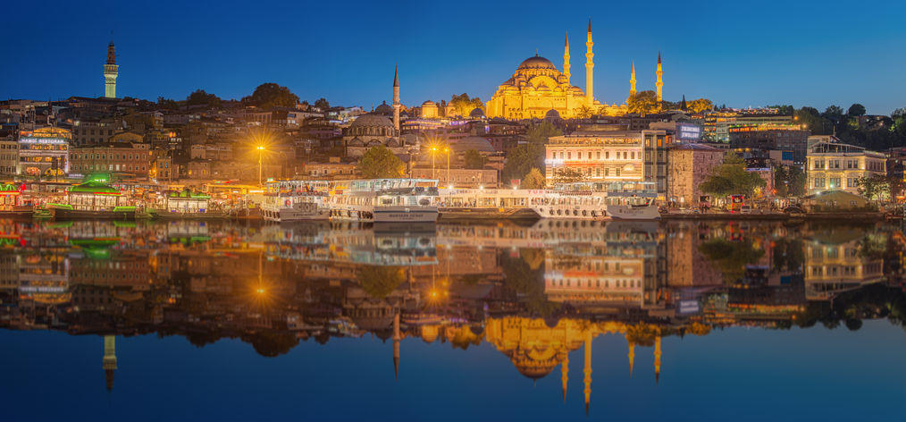 45716330 - istanbul skyline from galata bridge by night, with suleymaniye mosque and fish boat ferry
