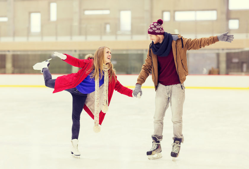 47664063 - people, friendship, sport and leisure concept - happy couple holding hands on skating rink