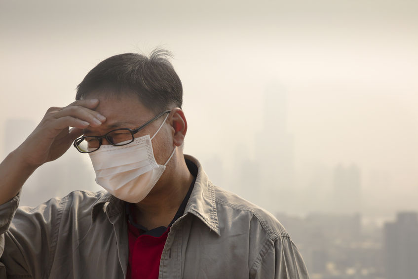 48387435 - asian man wearing mouth mask against air pollution