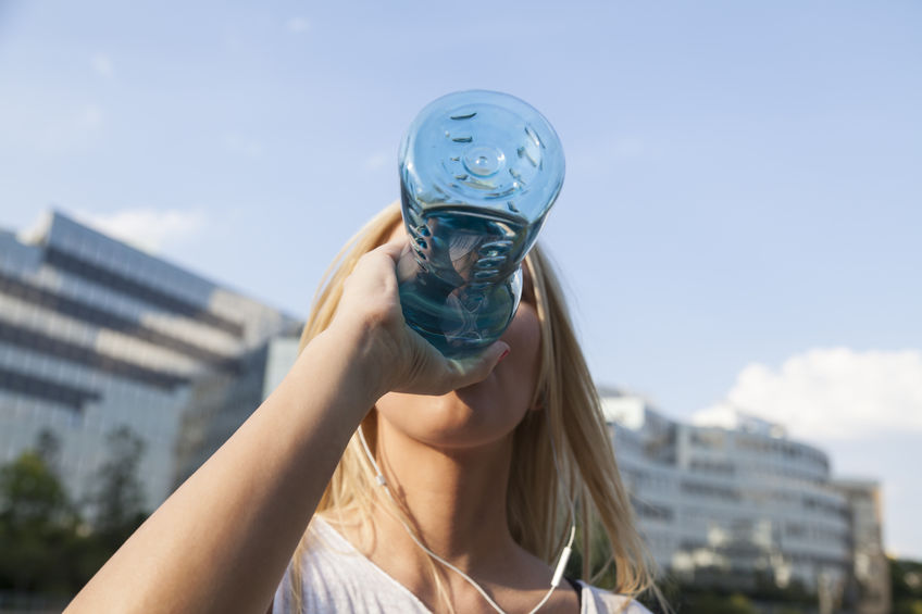 50826642 - thirsty woman drinking from a botte water
