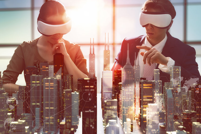 54018554 - two business persons are developing a project using virtual reality goggles. the concept of technologies of the future