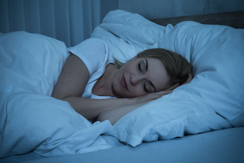 43306299 - young woman with blanket sleeping at night in bed