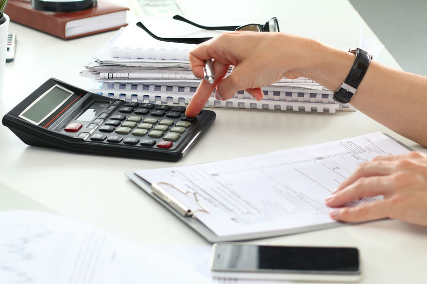 45107432 - close up of female accountant or banker making calculations. savings, finances and economy concept