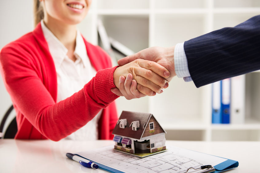 47948359 - two business people shaking hands as successful agreement