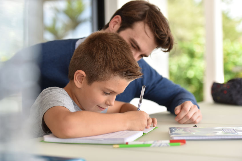 50356079 - man helping son with homework