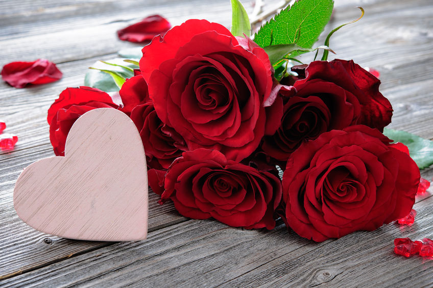50773447 - red roses and heart on wooden background. valentines day background
