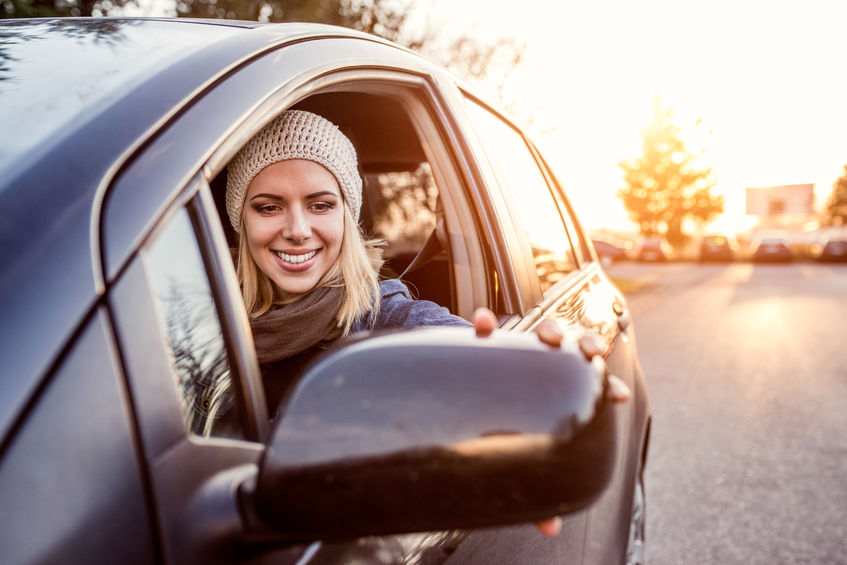 51583722 - beautiful young blond woman driving a car