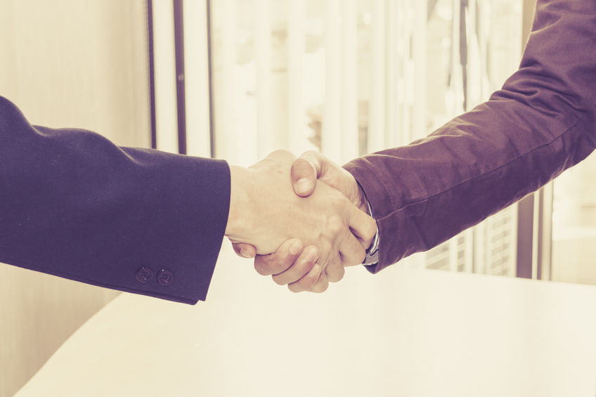 65288085 - the two businessmen shake hands after successfully doing business.