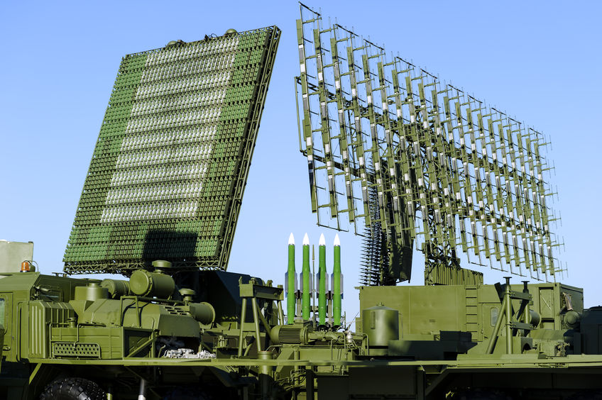 68417069 - air defense radars of military mobile antiaircraft systems in green color and ballistic rocket launcher with four cruise missiles in centre of frame, modern army industry