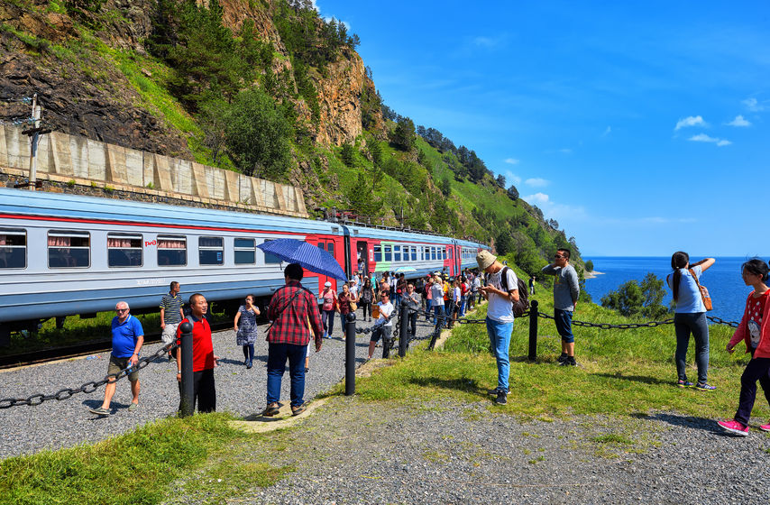 68595185 - kirkirey, irkutsk region, russia - july, 29,2016: baikal express. tourists from different countries visiting sights of circum-baikal railway. stopping 123 kilometer - a place of joining trans-siberian railway in 1904