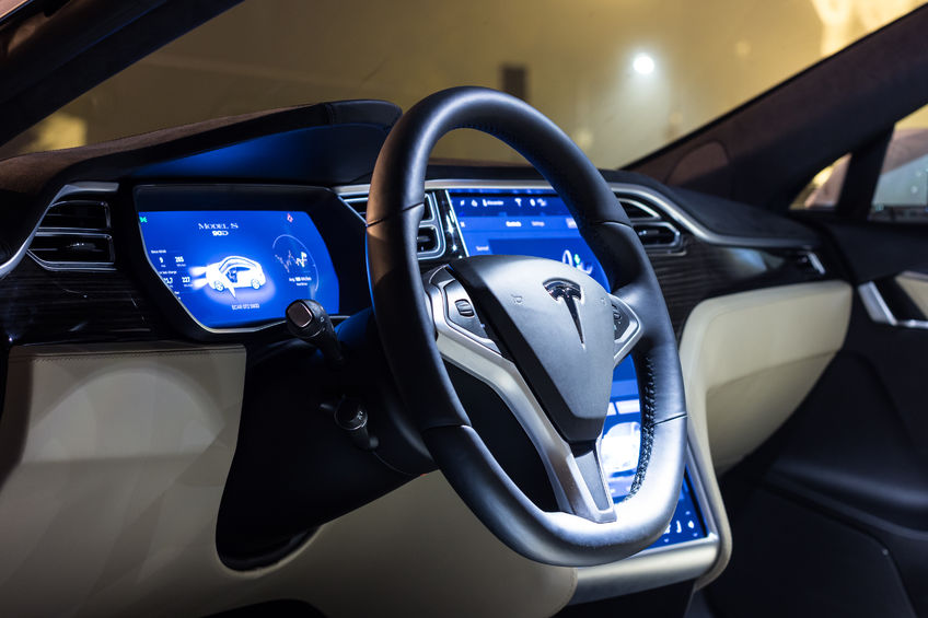 68771042 - ljubljana, slovenia - october 13, 2016: the interior of a tesla model s electric car with steering wheel and dashboard at night