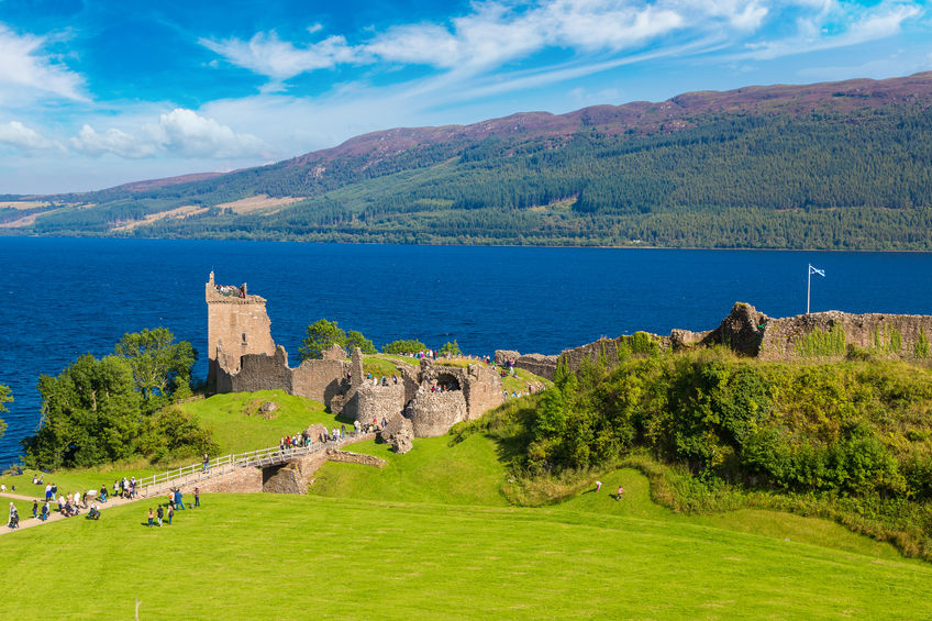 70733684 - urquhart castle along loch ness lake in scotland in a beautiful summer day, united kingdom