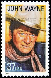 10419728 - usa - circa 2004: a stamp printed in united states of america shows famous american movies western actor john wayne, circa 2004