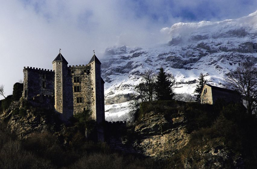 11424364 - miolans castle, where the marquis de sade was imprisoned, and snow on mountains
