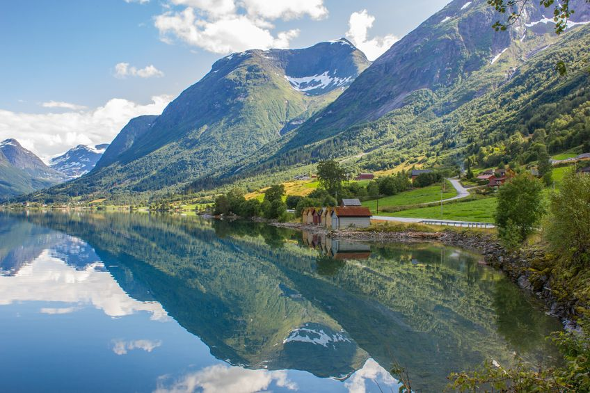 19289905 - scenic norway with mountain backdrop reflecting in the fjord water