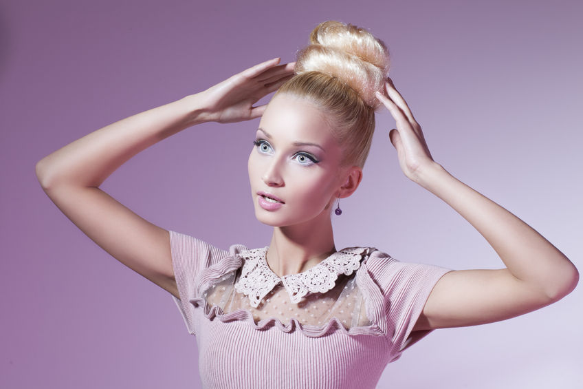 26351655 - portrait of beautiful blond girl in pink dress looking like barbie doll over pink
