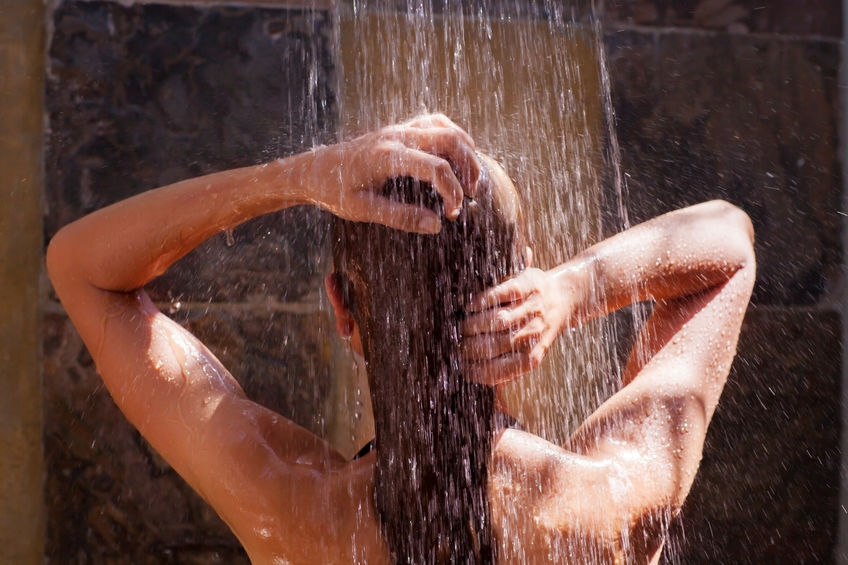 43454661 - woman in the shower, back side of young female showering under refreshing water, healthy lifestyle, enjoying time in luxury spa resort