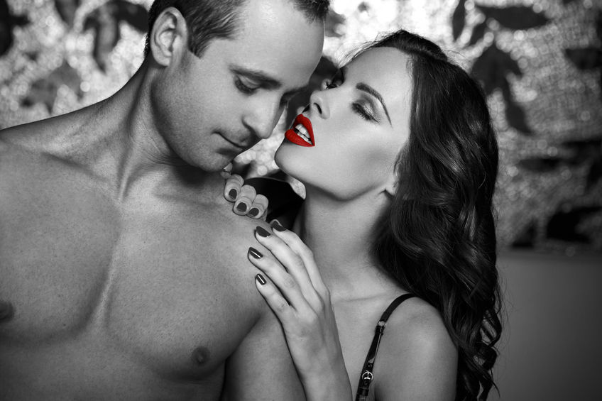 45610215 - sexy couple foreplay in selective coloring style, red lips, black and white