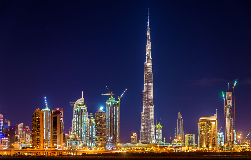 52459804 - night view of dubai downtown with burj khalifa