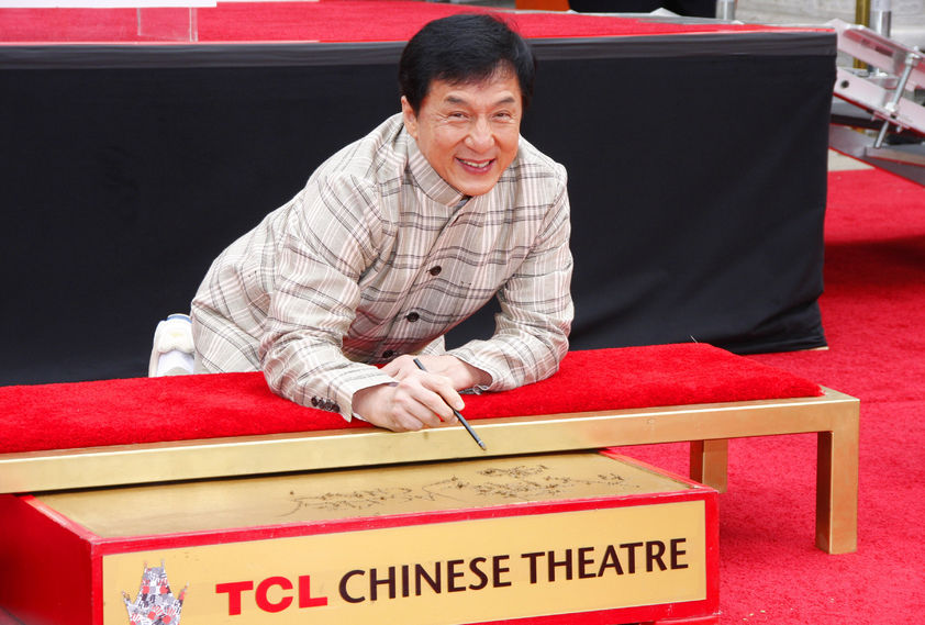 56053361 - jackie chan at the jackie chan hand and foot print ceremony held at the tcl chinese theatre in hollywood, usa on june 6, 2013.