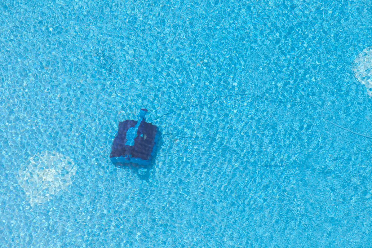Robot cleaning a swimming pool, under water