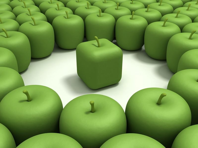 11888030 - green apple of the cubic form in an environment of usual green apples.