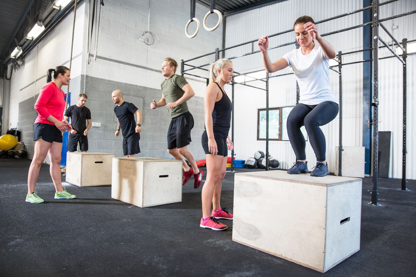 29841837 - crossfit group trains box jumps