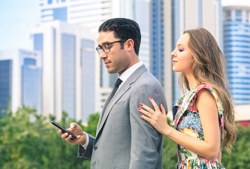 36239662 - young hipster couple in moment of mutual disinterest - concept of breaking up connected to the alienation from new trends and technologies - ignored girlfriend trying to keep attention from boyfriend