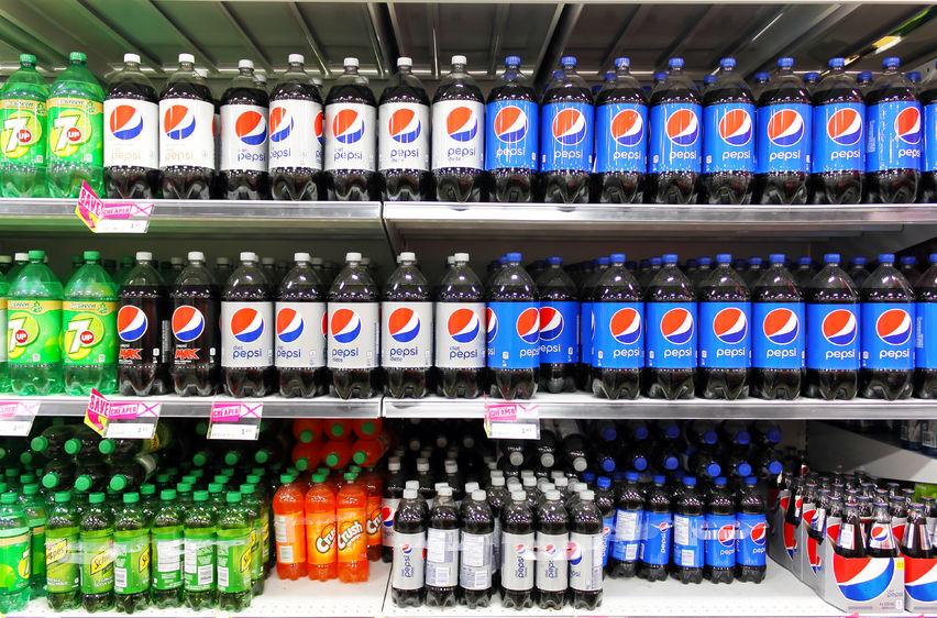 38140412 - bottled soft drinks on shelves in a supermarket