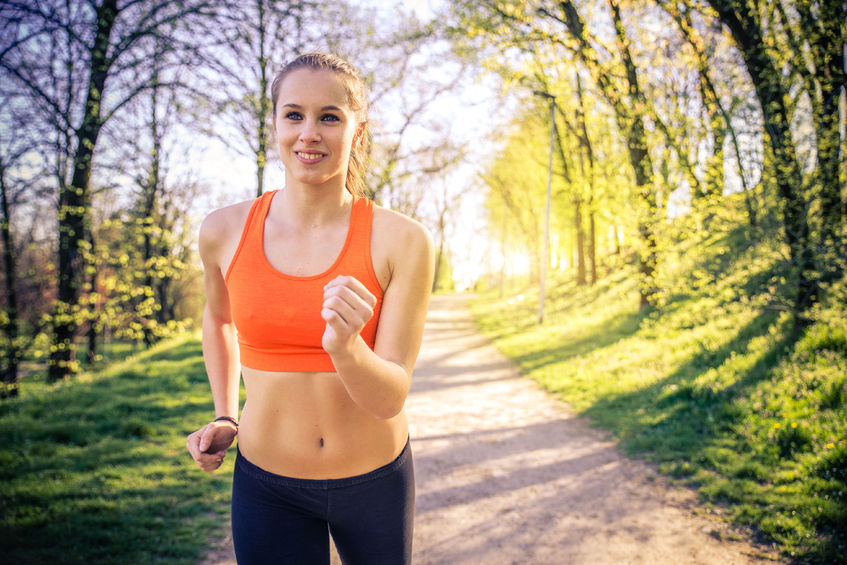 38769427 - young sportive woman training in a park for marathon - athlete running outdoors at sunset - attractive girl making sport to lose weight and stay fit