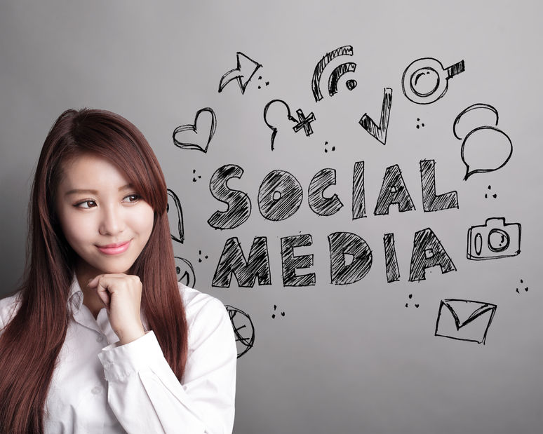 40856199 - social media concept - business woman look social media text and icon on grey background, asian