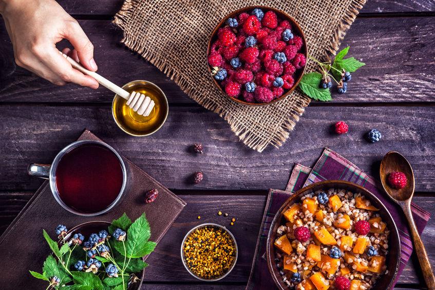 43074871 - healthy breakfast with pumpkin porridge, berries and herbal tea with honey at village summer house