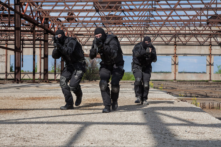 43537891 - special forces operators in black uniform in action