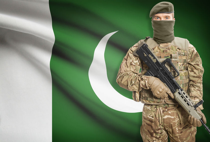48652117 - soldier holding machine gun with national flag on background - pakistan